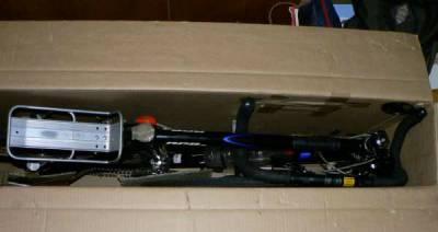 велосипед, упакованный в коробку