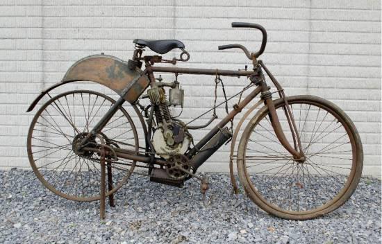 старинный моторизованный велосипед
